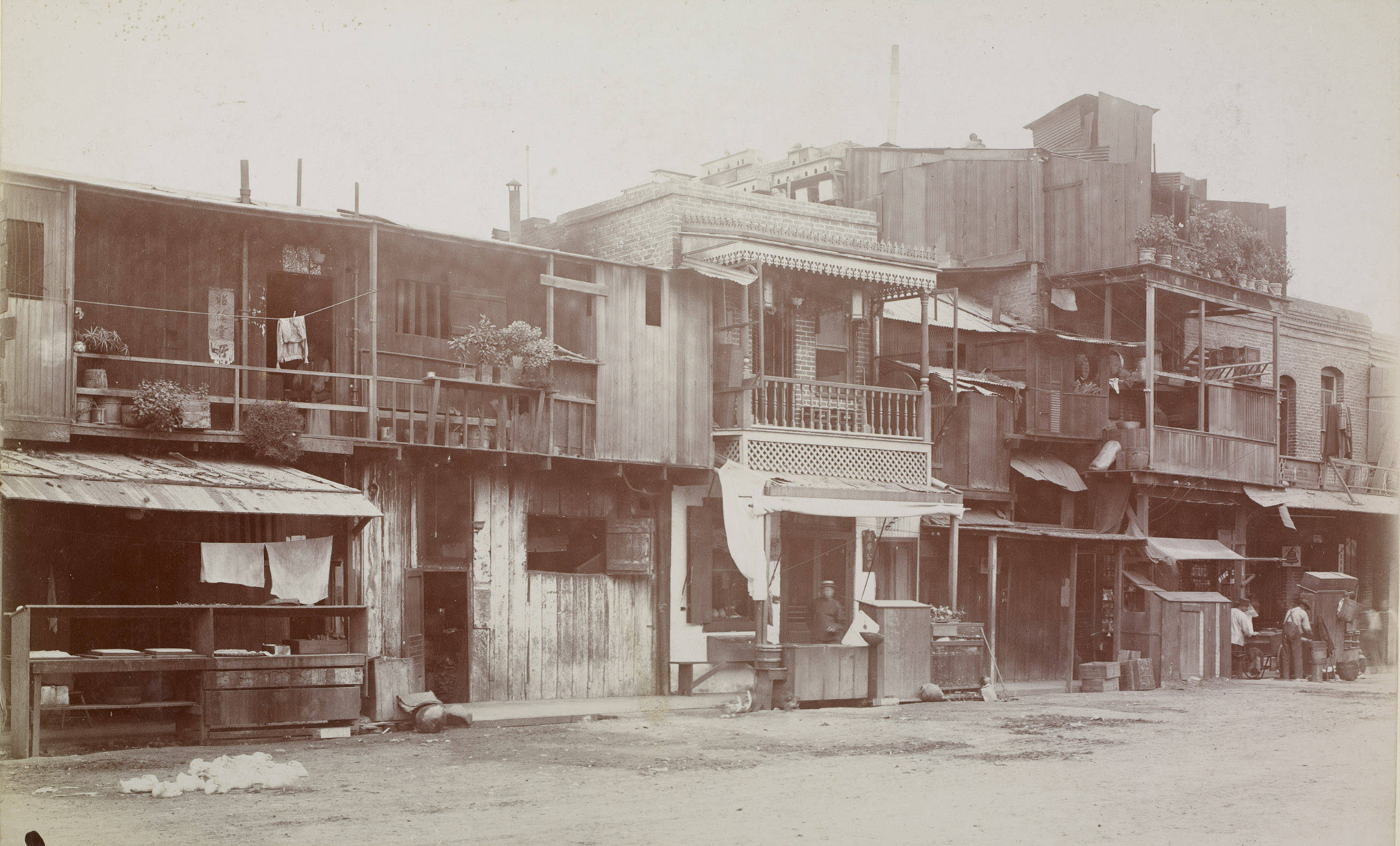 Street view of dwellings and businesses in Old Chinatown (1888)