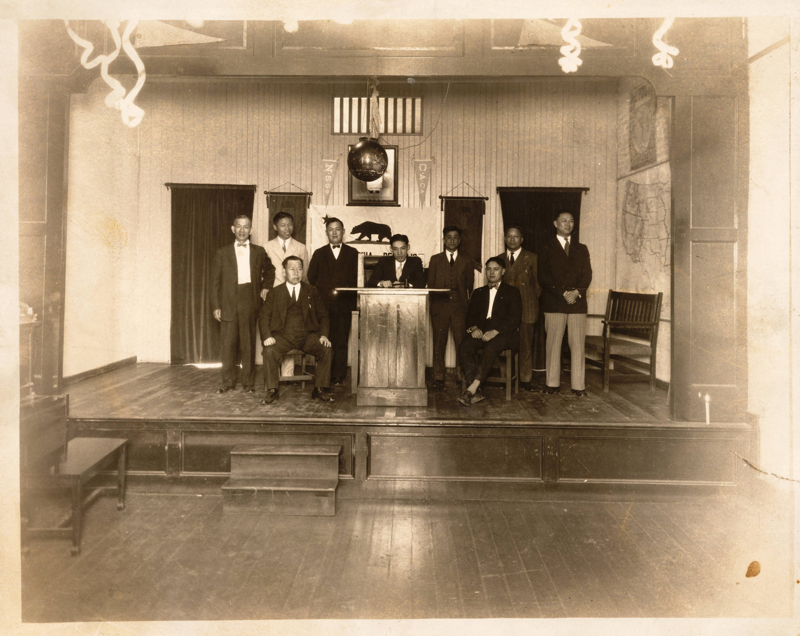 Y. C. Hong (center, behind podium) and members of the Chinese American Citizens Alliance (1928)