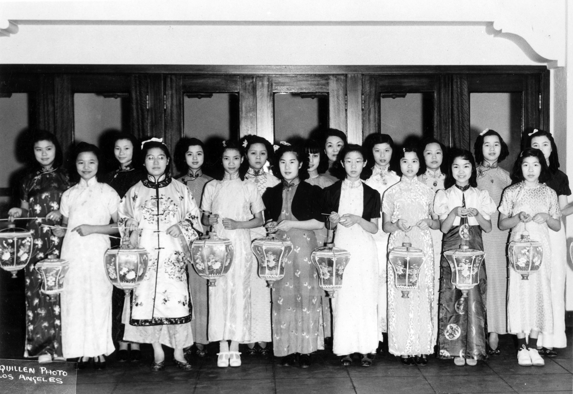 Young women in traditional Chinese dress with lanterns at Moon Festival celebration (1940)