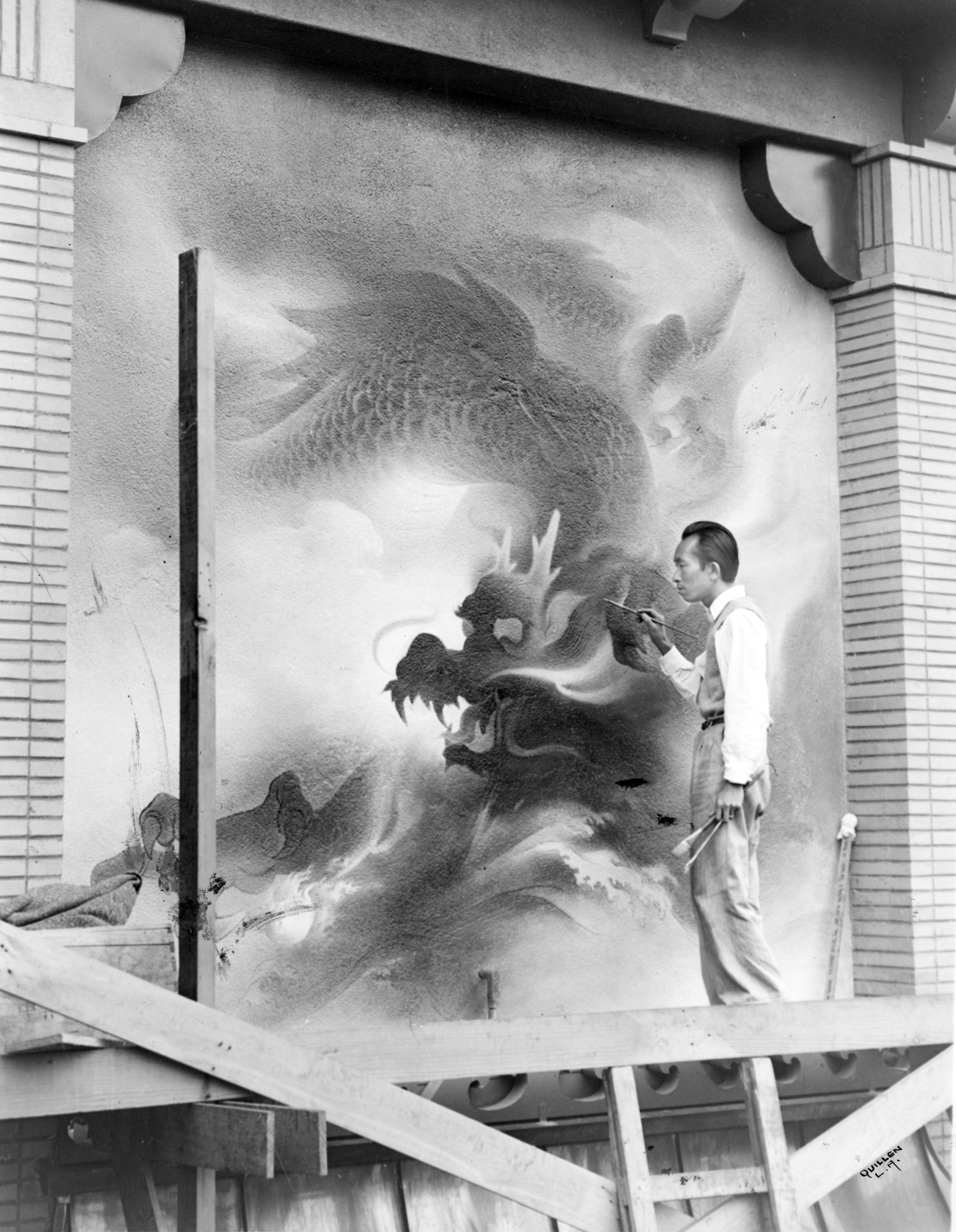 Artist Tyrus Wong paints a dragon mural on building exterior in Chinatown Central Plaza (1941)