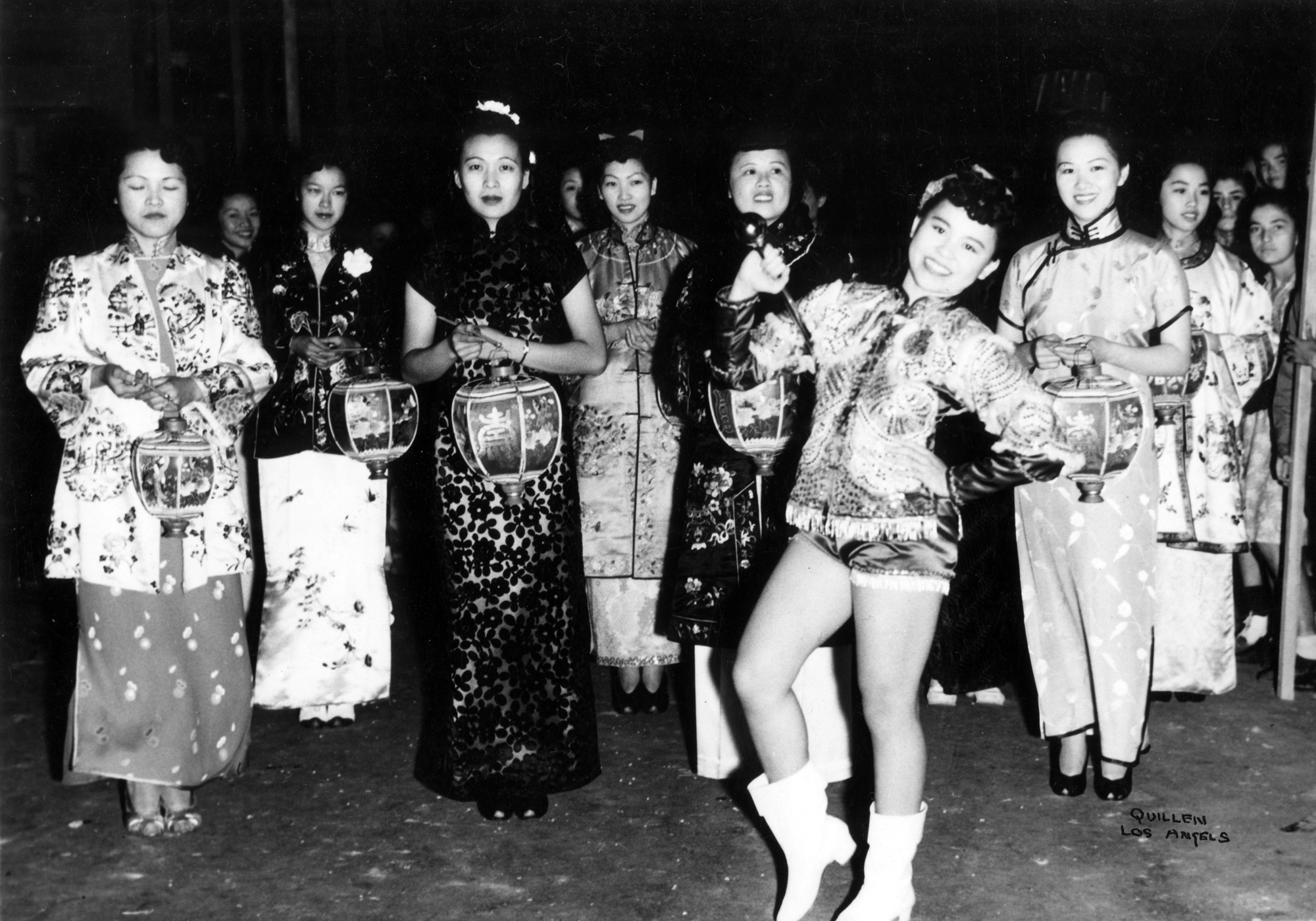 Barbara Jean Wong Lee leads the Mei Wah Drum Corps Lantern Parade for New Chinatown's 2nd Anniversary celebration (1940)